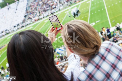 istock Taking a picture at sporting event 186590070