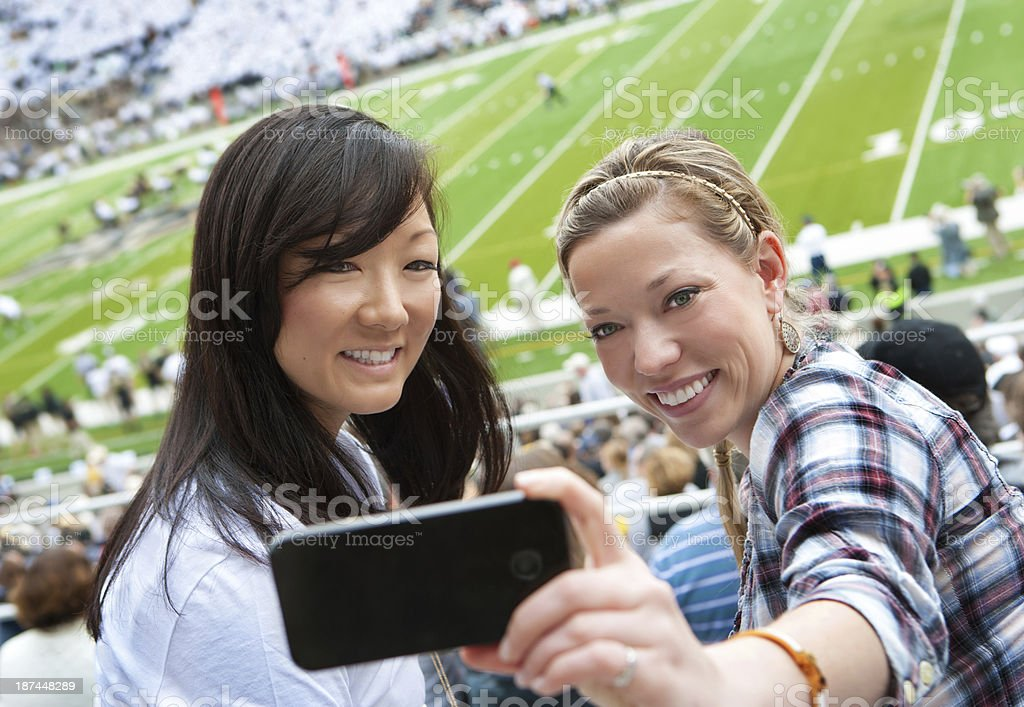 Taking a picture at sporting event stock photo