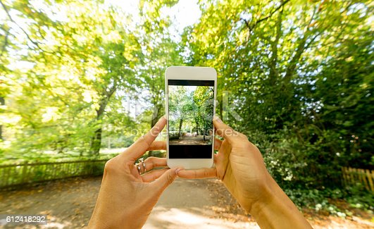 599114758 istock photo Taking a picture of a beautiful landscape 612418292