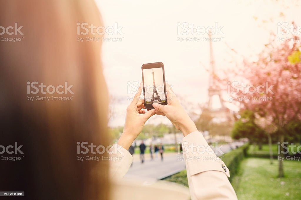 Taking a picture of the Eiffel Tower stock photo