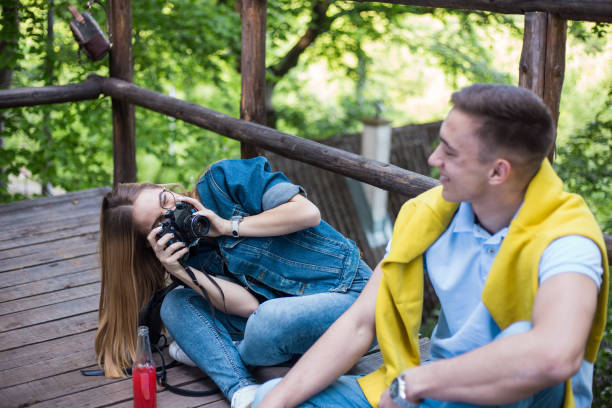 Taking a picture with an old camera is always funny stock photo