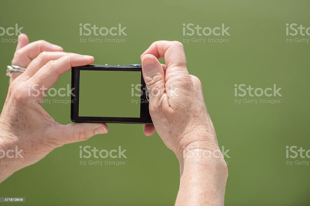 Taking a picture with small digital camera royalty-free stock photo