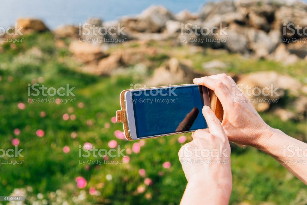 Taking a picture with smartphone royalty-free stock photo