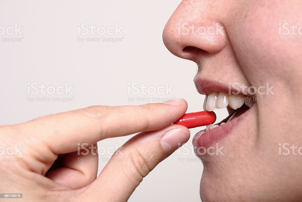 Taking a pill royalty-free stock photo