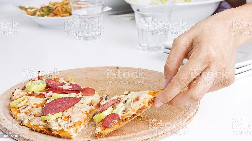 Taking a pizza slice stock photo