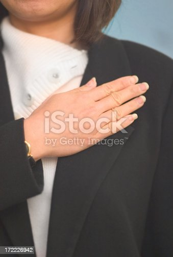Upclose shot of a woman taking a pledge. Low depth of field focus on the hand.