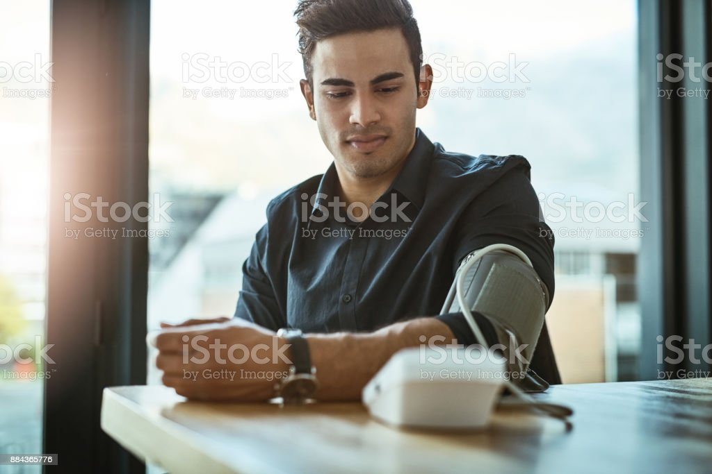 Taking a quick reading of his blood pressure stock photo
