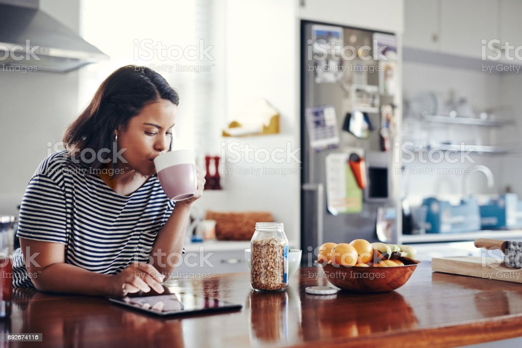 Taking a scroll through all her networks stock photo