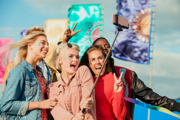 taking a selfie at a music festival - concert selfie stock photos and pictures