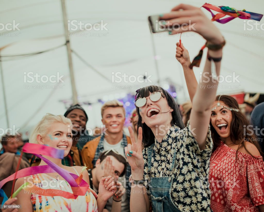 Taking a Selfie at a Music Festival stock photo