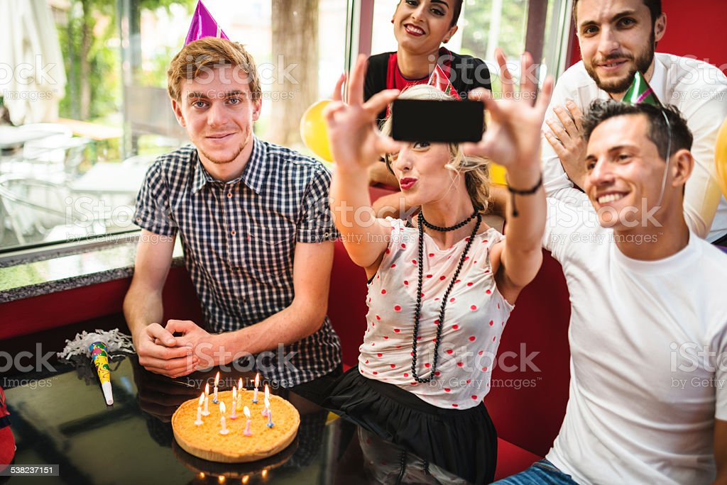 taking a selfie during a birthday party stock photo