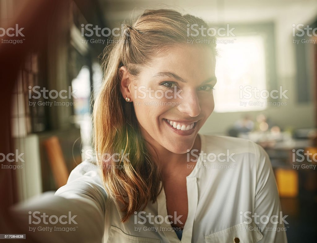 Taking a selfie in her favourite coffee shop stock photo