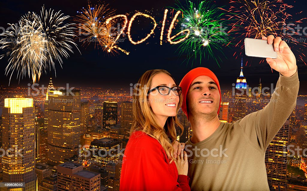Taking a selfie in New York City fireworks stock photo