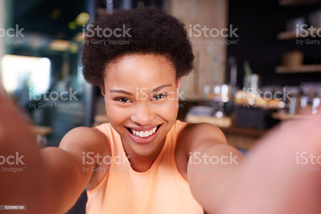 Taking a selfie in the coffee shop stock photo