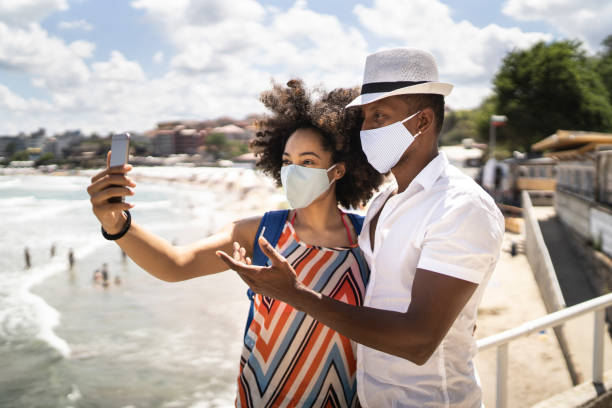 Taking a selfie in time of new vacation's conditions stock photo
