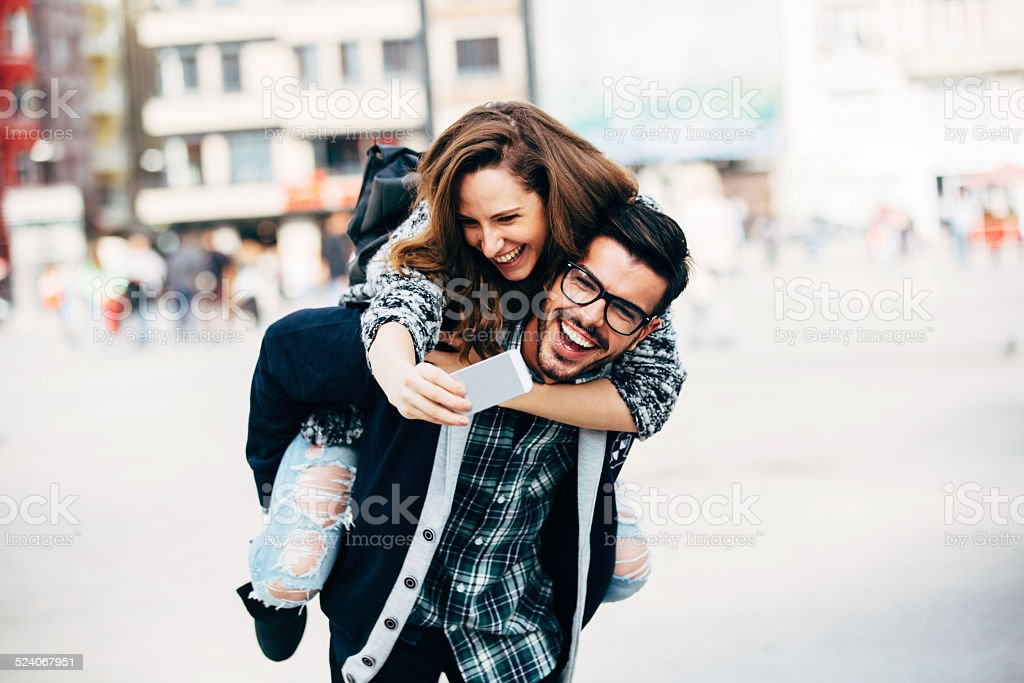 Taking a selfie on piggy back stock photo