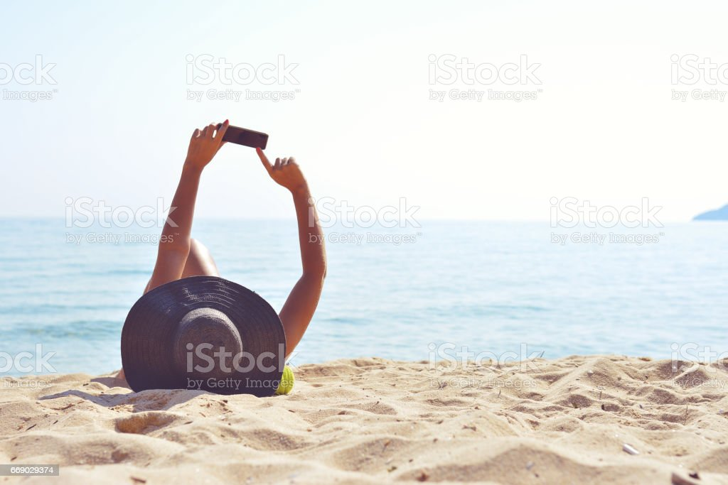 Taking a selfie on the beach stock photo