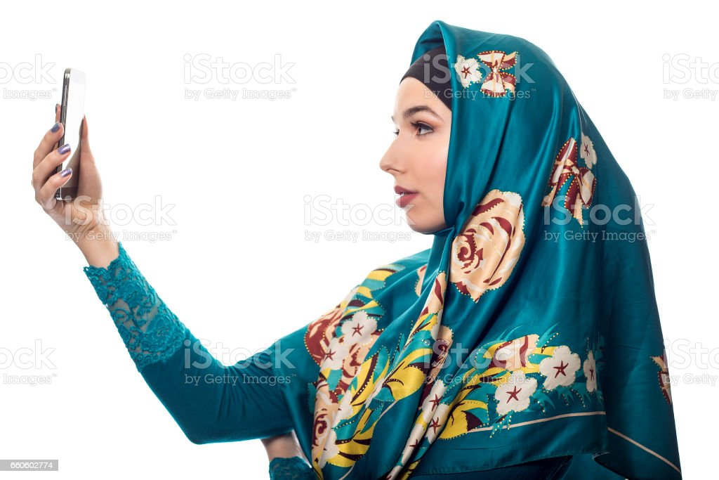 Taking a Selfie While Wearing a Hijab royalty-free stock photo