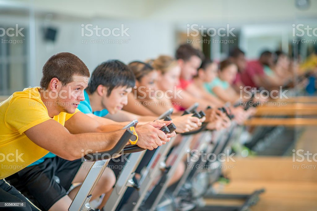 Taking a Spin Class at the Gym stock photo