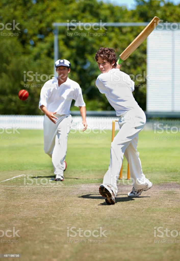 Taking a swing to win! stock photo