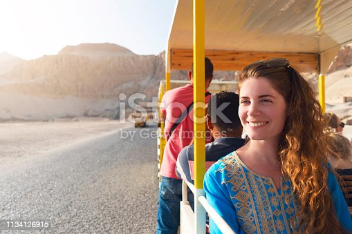 Beautiful caucasian woman enjoying a tour to the Hatshepsut Temple in Egypt.