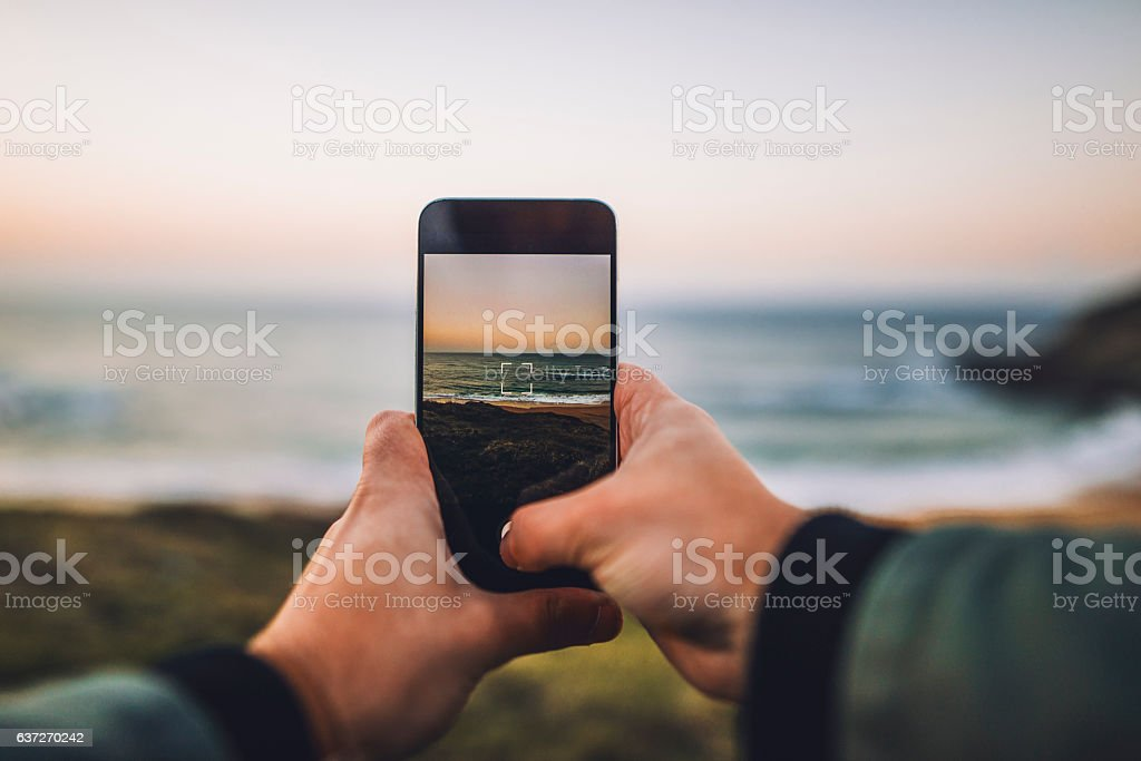 Taking a vertical picture at sunset stock photo