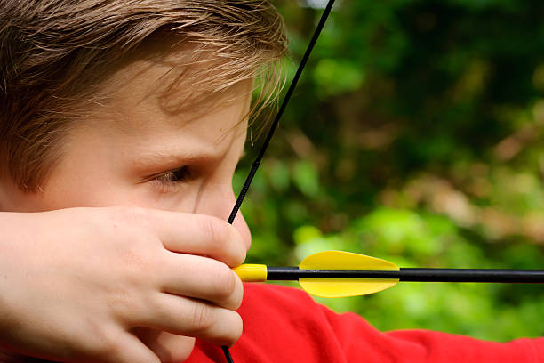 Taking Aim at Archery with Red Shirt stock photo