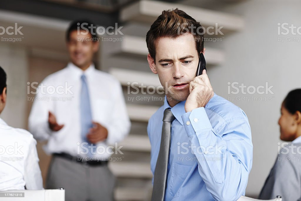 Taking an important call during a presentation royalty-free stock photo