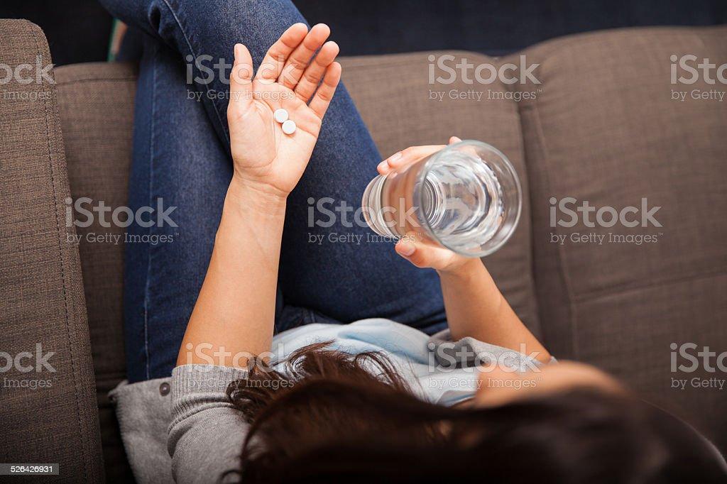 Taking aspirins for a headache stock photo