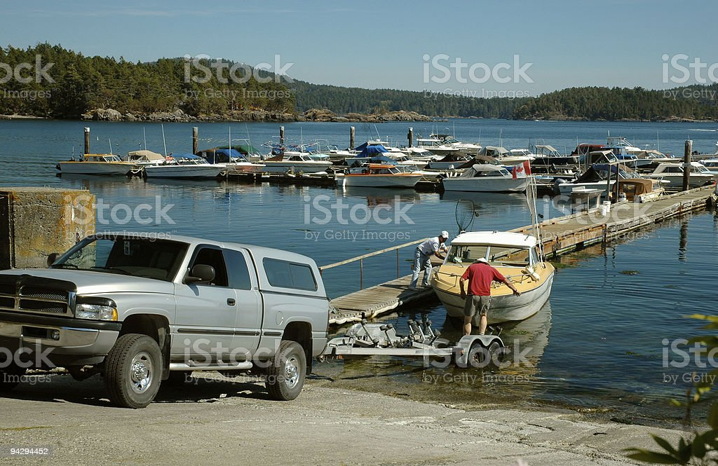 Taking boat out of water stock photo