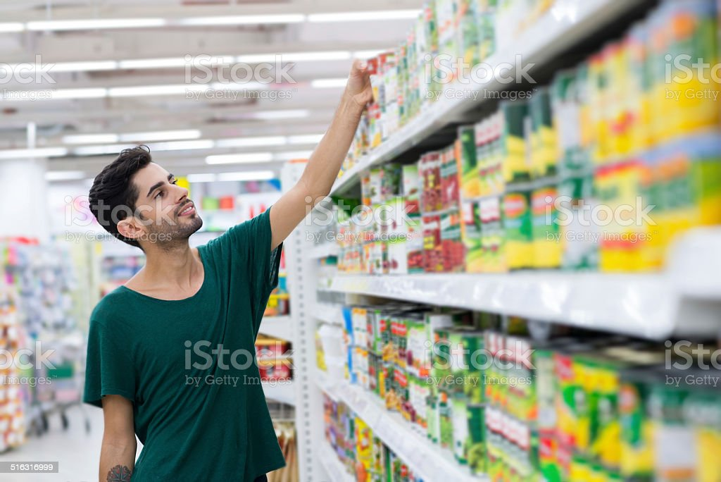 Taking canned food stock photo