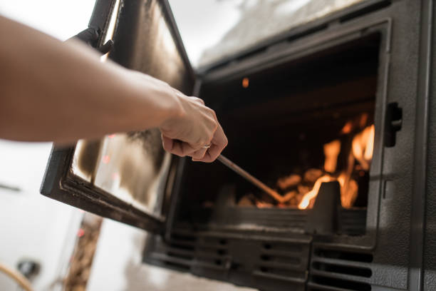 Taking care of fire in fireplace stock photo