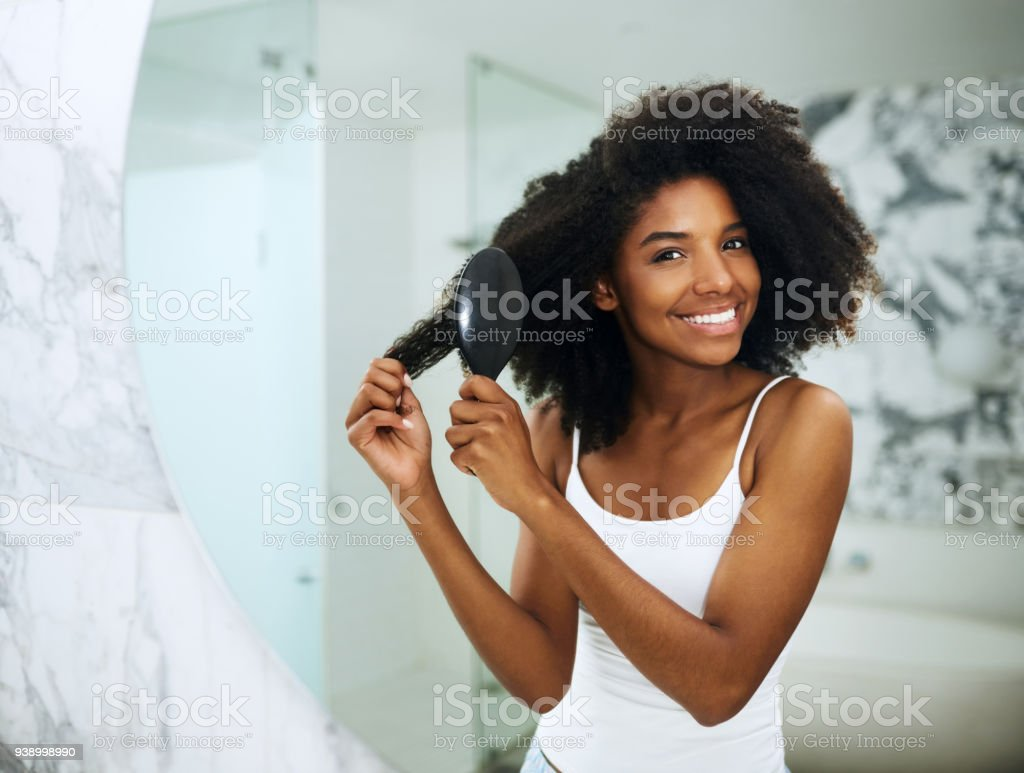 Taking care of her crown stock photo