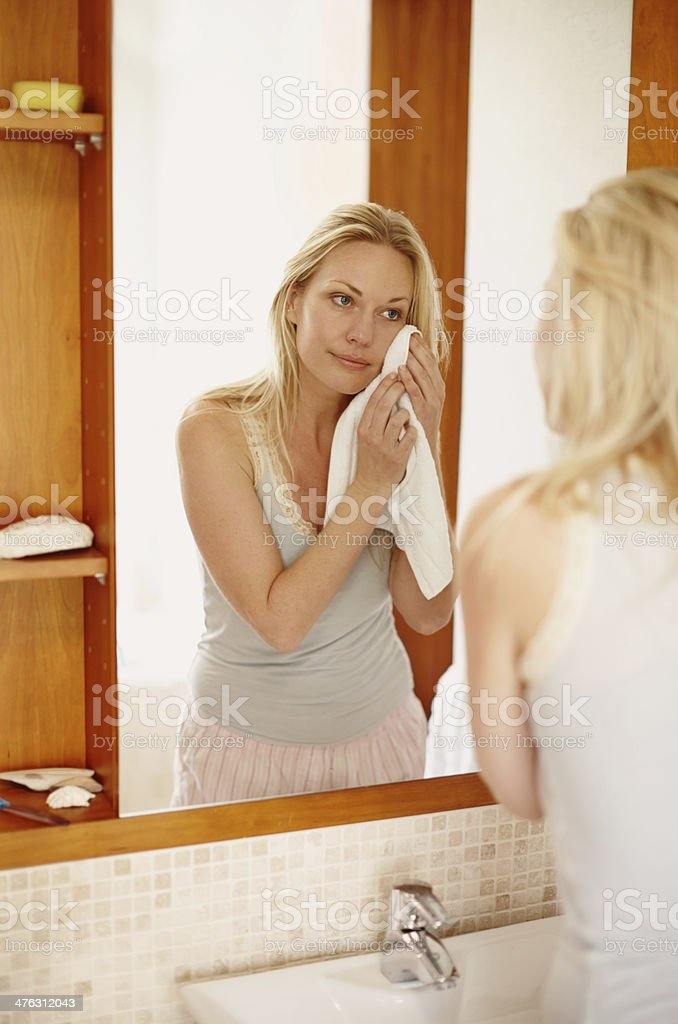 Taking care of her flawless complexion stock photo