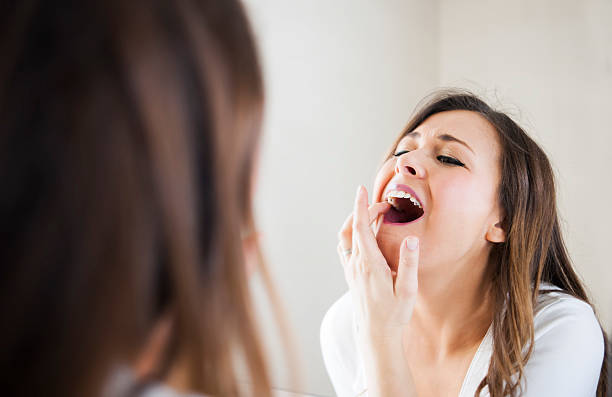 Taking care of her skin and teeth stock photo