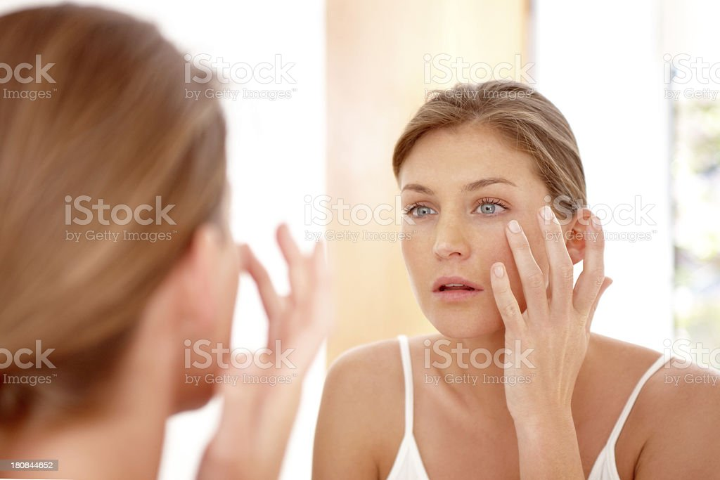Taking care of her skin stock photo