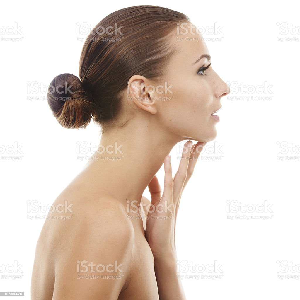 Taking care of her skin royalty-free stock photo
