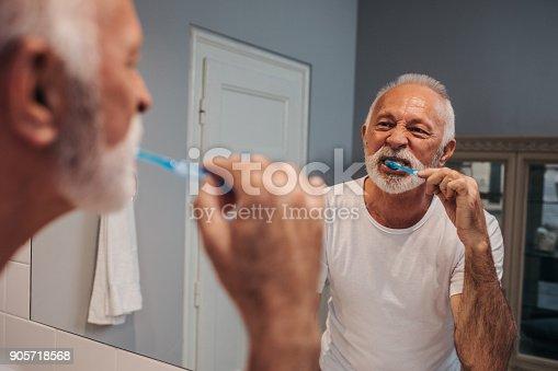istock Taking care of his teeth 905718568