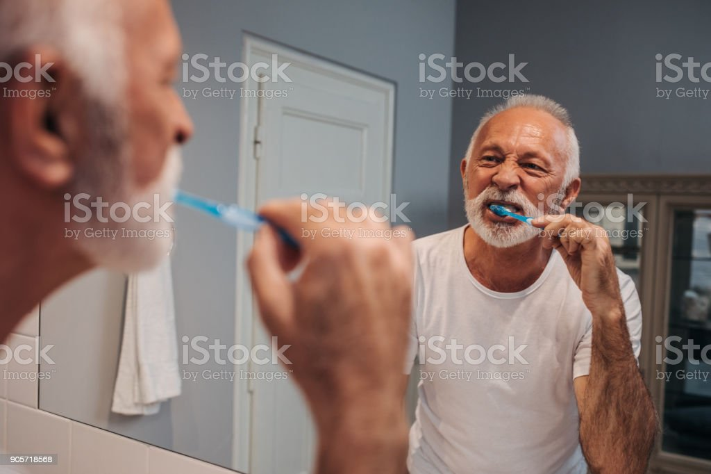 Taking care of his teeth stock photo