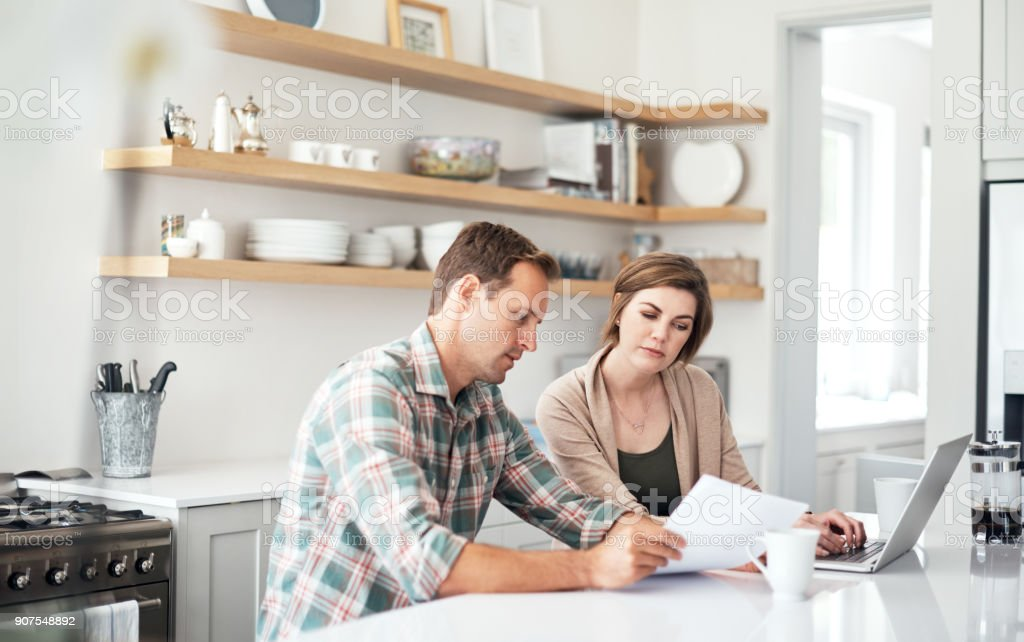 Taking care of their household finances stock photo
