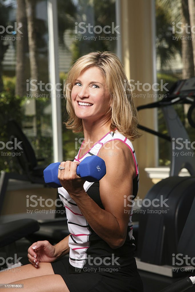 Taking care of yourself  Female fitness workout with dumbbell weights royalty-free stock photo