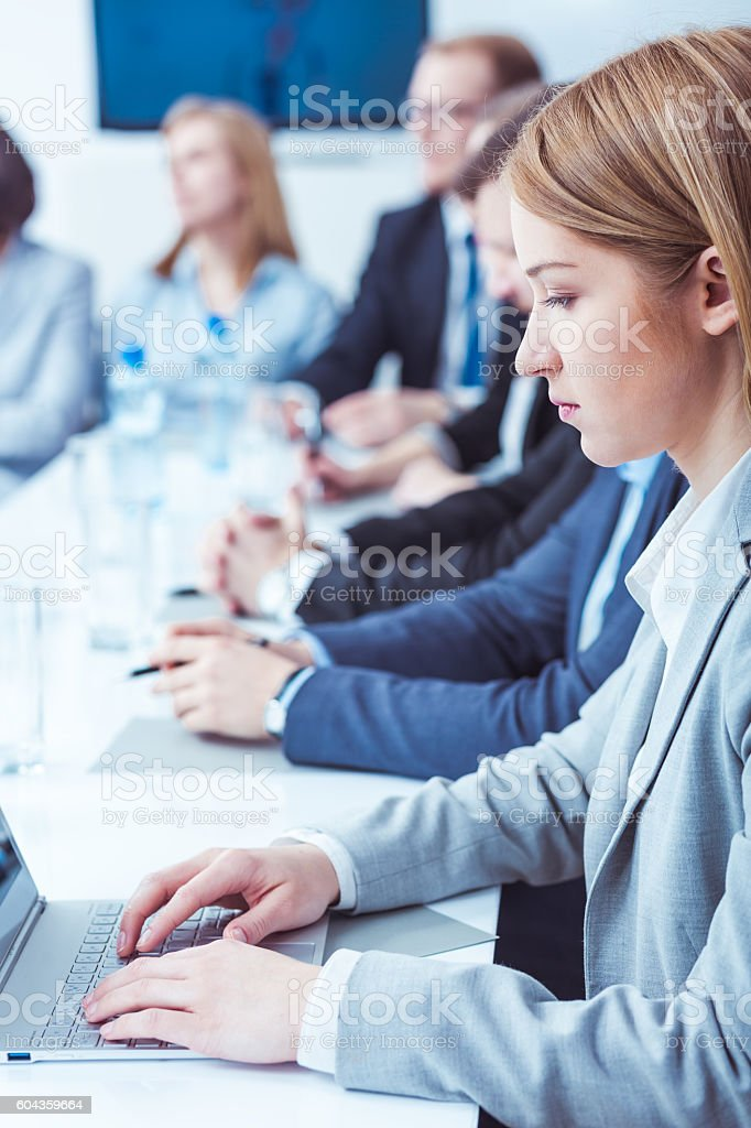 Taking careful notes of the meeting's conclusions - foto stock