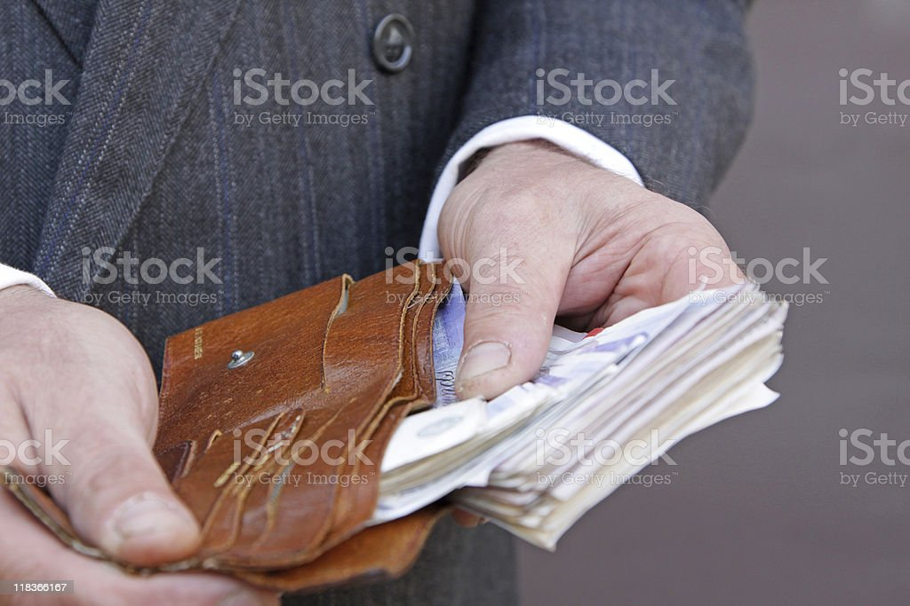 taking cash out of a wallet stock photo