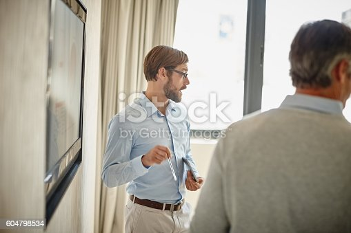istock Taking charge of an informative presentation 604798534