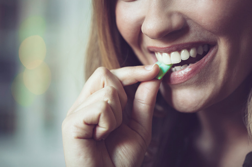 Taking chewing gum stock photo