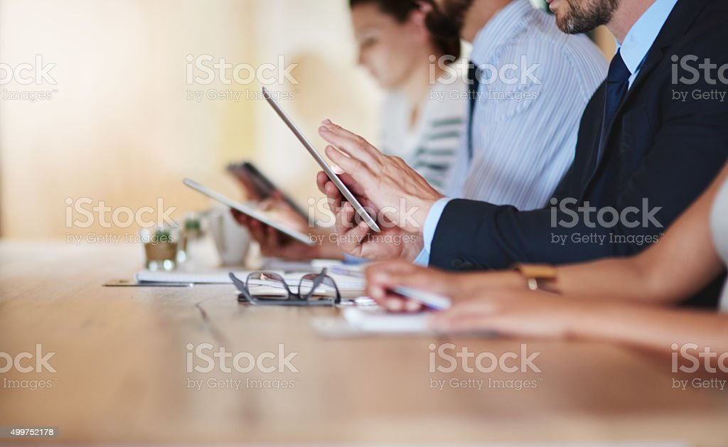 Taking digital notes stock photo