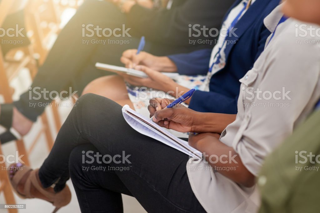 Taking down notes to take back with them stock photo
