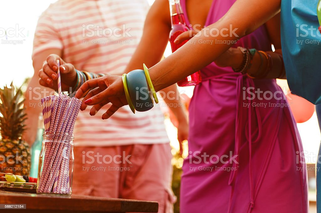 Taking drinking straws on a party stock photo
