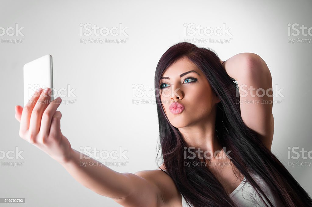 Taking duck face selfie stock photo