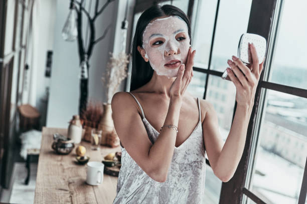 taking good care of her skin. - chemical peel stock pictures, royalty-free photos & images